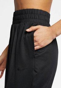 Nike Performance - FLOW - Spodnie treningowe - black - 3