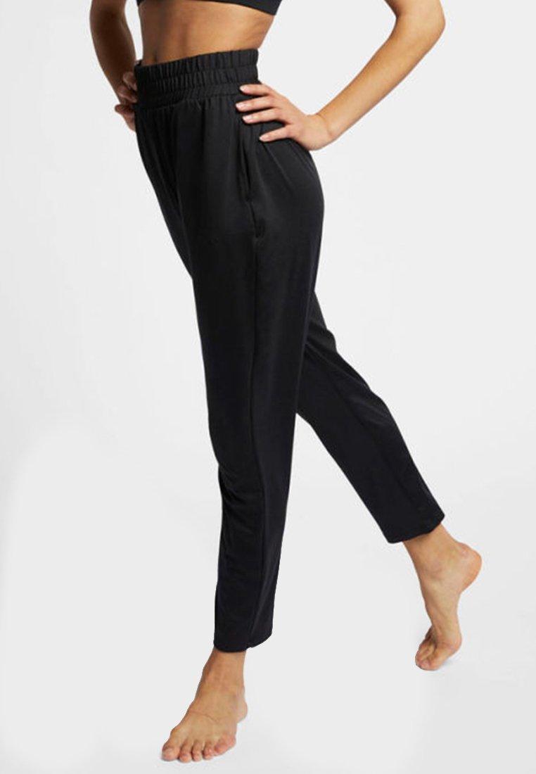 Nike Performance - FLOW - Spodnie treningowe - black