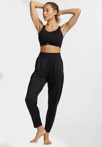 Nike Performance - FLOW - Spodnie treningowe - black - 1