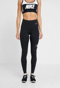 Nike Performance - ONE - Legginsy - black/white - 0