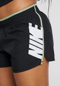Nike Performance - SHORT REBEL - Sports shorts - black/jade horizon/white - 4