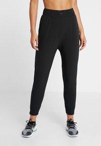 Nike Performance - BLISS PANT - Pantalones deportivos - black - 0