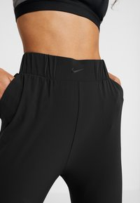 Nike Performance - BLISS PANT - Träningsbyxor - black - 4