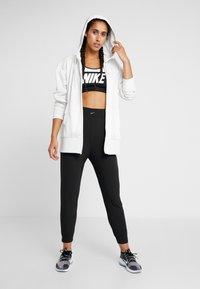 Nike Performance - BLISS PANT - Träningsbyxor - black - 1