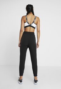 Nike Performance - BLISS PANT - Träningsbyxor - black - 2