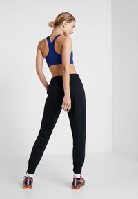 Nike Performance - DRY ALL IN PANT TAPER - Verryttelyhousut - black/white - 2