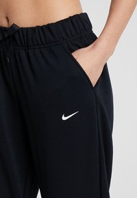 Nike Performance - DRY ALL IN PANT TAPER - Pantalon de survêtement - black/white - 4