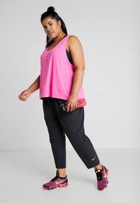 Nike Performance - PANT PLUS - Tracksuit bottoms - black/reflective silver - 1