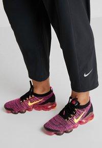 Nike Performance - PANT PLUS - Tracksuit bottoms - black/reflective silver - 3