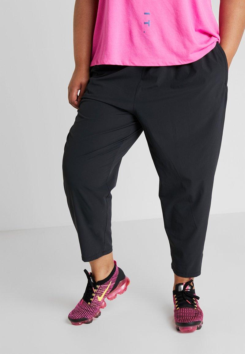 Nike Performance - PANT PLUS - Tracksuit bottoms - black/reflective silver