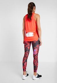 Nike Performance - FAST - Leggings - university red/silver - 2