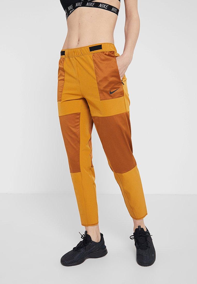 Nike Performance - REBEL - Trousers - burnt sienna/black
