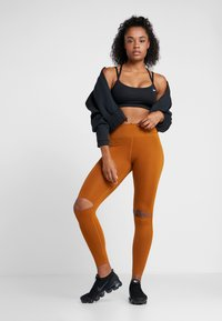 Nike Performance - REBEL ONE - Leggings - burnt sienna/black - 1