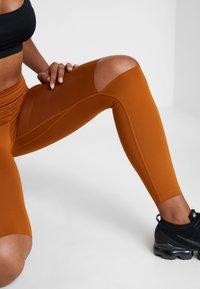 Nike Performance - REBEL ONE - Leggings - burnt sienna/black - 3