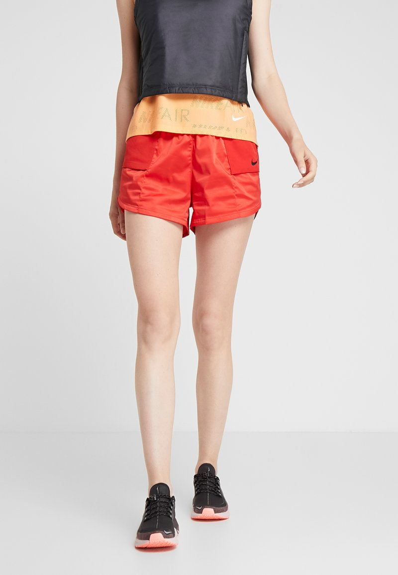 Nike Performance - W NK TEMPO LX REBEL - Sports shorts - university red