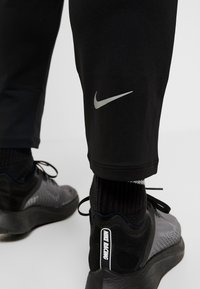 Nike Performance - TRACK PANT - Trainingsbroek - black/reflective silver - 6