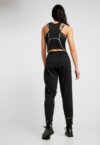 Nike Performance - TRACK PANT - Trainingsbroek - black/reflective silver - 2