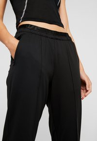 Nike Performance - TRACK PANT - Trainingsbroek - black/reflective silver - 3