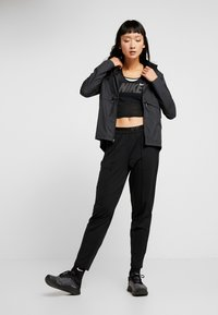 Nike Performance - TRACK PANT - Trainingsbroek - black/reflective silver - 1