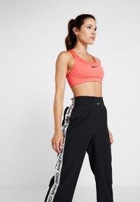 Nike Performance - CAPSULE TEAR AWAY PANT - Tracksuit bottoms - black/metallic silver - 3