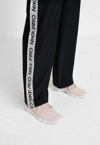 Nike Performance - CAPSULE TEAR AWAY PANT - Tracksuit bottoms - black/metallic silver - 4