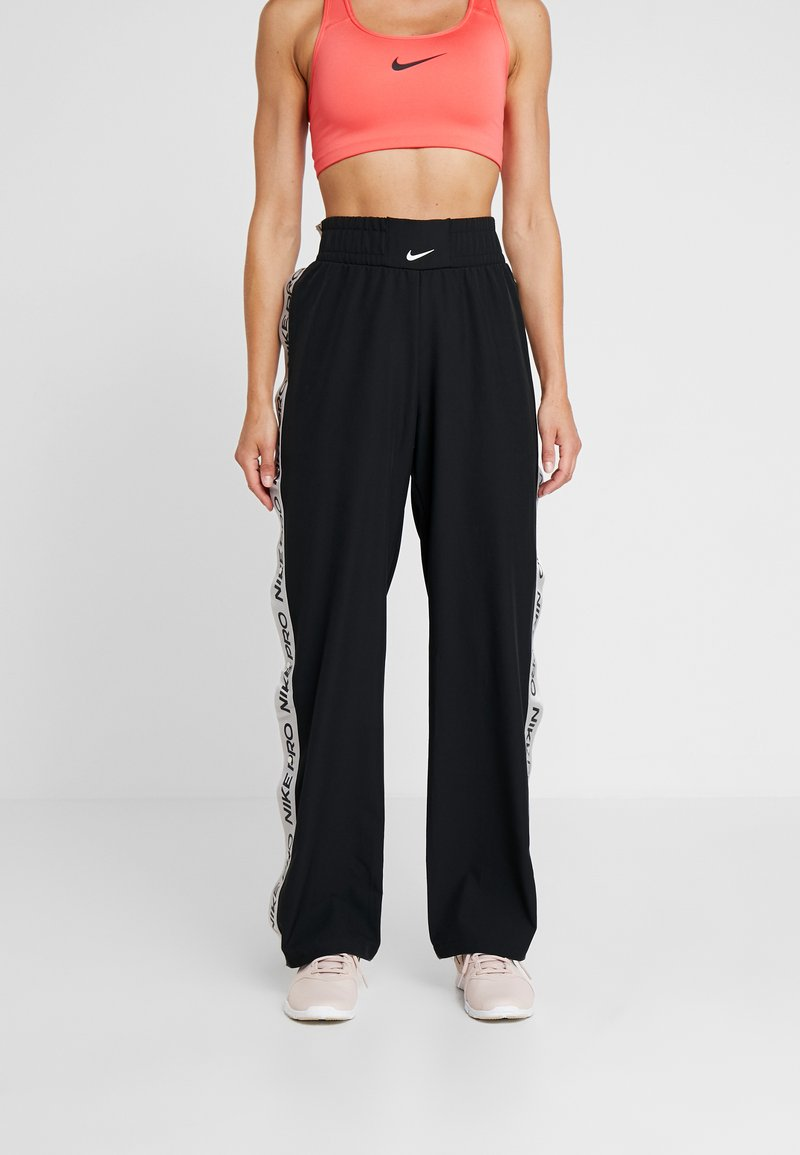 Nike Performance - CAPSULE TEAR AWAY PANT - Tracksuit bottoms - black/metallic silver