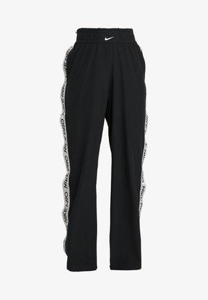 CAPSULE TEAR AWAY PANT - Tracksuit bottoms - black/metallic silver