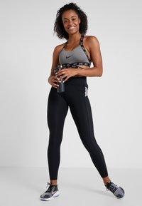 Nike Performance - CAPSULE  AERO ADAPT - Tights - black/metallic silver - 1