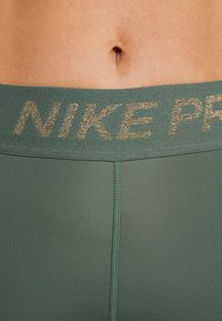Nike Performance - FIERCE TIGHT - Tights - juniper fog/metallic gold - 6