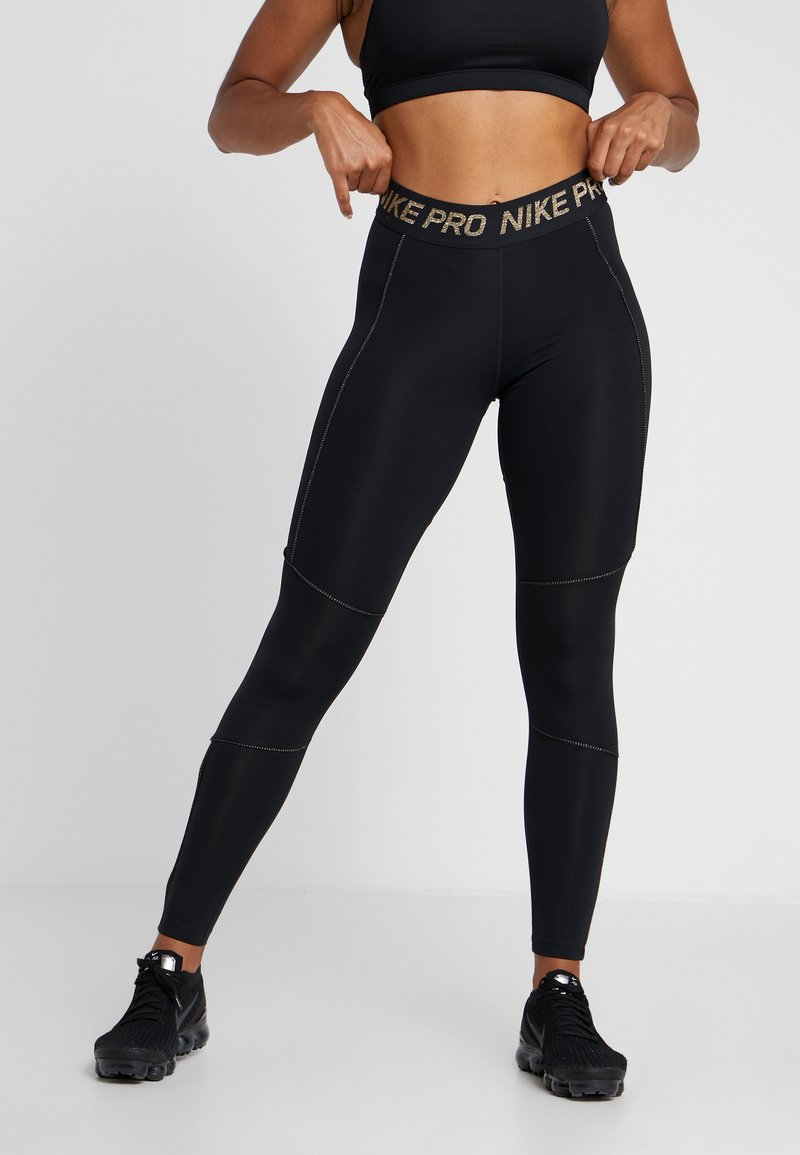 Nike Performance - FIERCE TIGHT - Tights - black/metallic gold