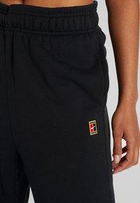 Nike Performance - HERITAGE PANT - Træningsbukser - black - 4