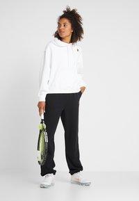 Nike Performance - HERITAGE PANT - Pantaloni sportivi - black - 1