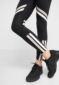 Nike Performance - ONE ICON - Leggings - black/metallic gold/white - 5