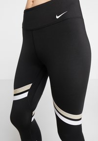 Nike Performance - ONE ICON - Leggings - black/metallic gold/white - 3