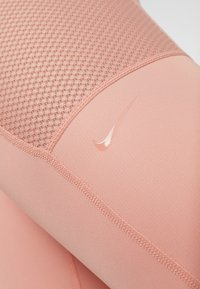 Nike Performance - WARM HOLLYWOOD - Tights - pink quartz/clear - 5