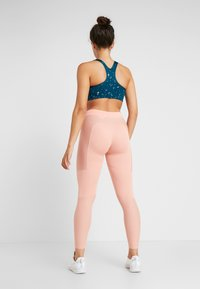 Nike Performance - WARM HOLLYWOOD - Tights - pink quartz/clear - 2