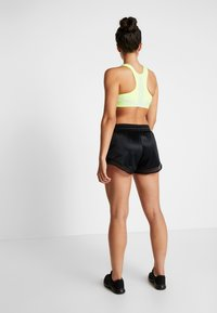 Nike Performance - SHORT GLAM - Urheilushortsit - black/metallic gold - 2