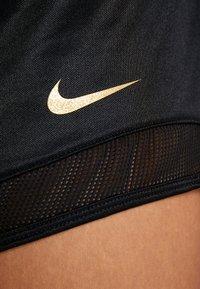 Nike Performance - SHORT GLAM - Urheilushortsit - black/metallic gold - 4
