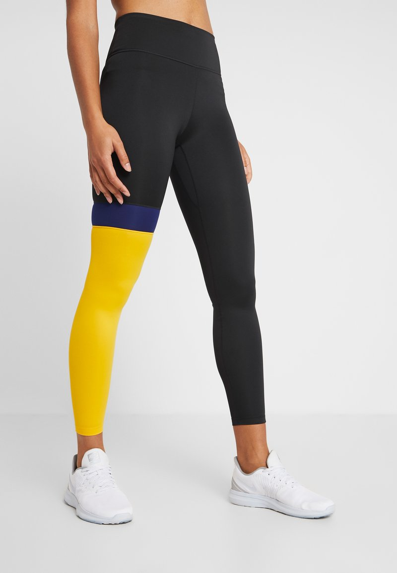 Nike Performance - ONE - Legginsy - black/university gold/white