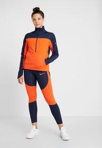 Nike Performance - EPIC LUX - Legginsy - obsidian/team orange/silver - 1