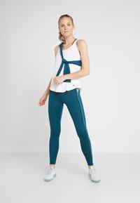 Nike Performance - HYPERWARM - Legging - midnight turq/metallic silver - 1