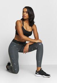 Nike Performance - TOSS PRINT - Leggings - iron grey/black - 1