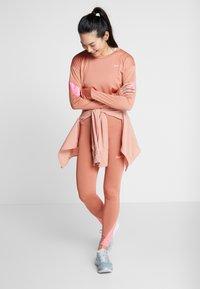 Nike Performance - FAST RUNWAY - Leggings - terra blush/digital pink - 1