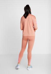 Nike Performance - FAST RUNWAY - Leggings - terra blush/digital pink - 2