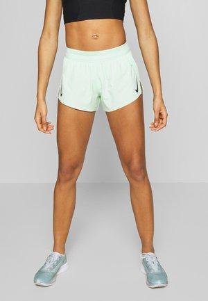 AEROSWIFT - Pantalón corto de deporte - vapor green/black
