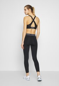Nike Performance - TIGHT 7/8  - Leggings - black/white - 2