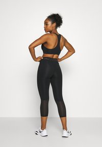 Nike Performance - CROP - Leggings - black/metallic silver - 2