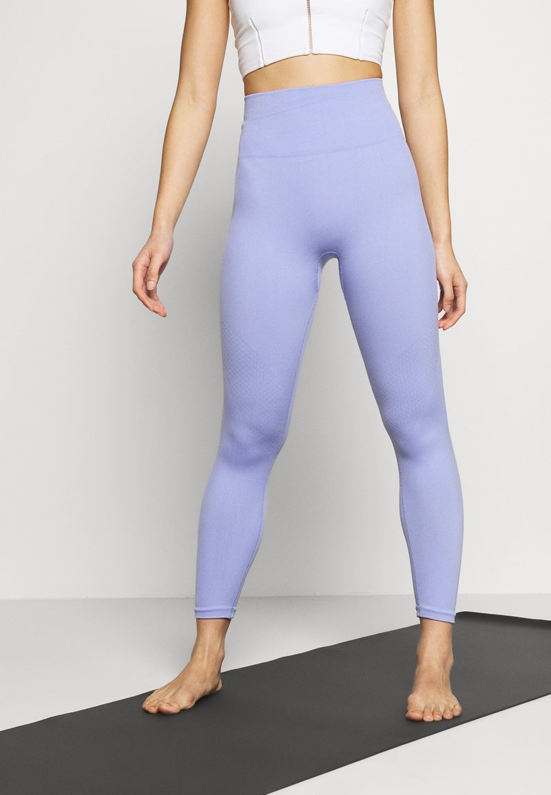 Nike Performance - SEAMLESS 7/8 - Leggings - light thistle/white