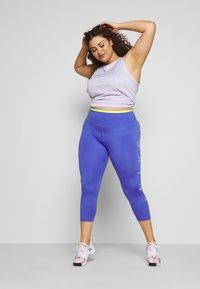 Nike Performance - 3/4 sports trousers - sapphire/lemon/light thistle - 1