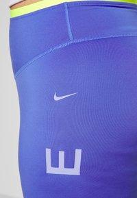 Nike Performance - 3/4 sports trousers - sapphire/lemon/light thistle - 5